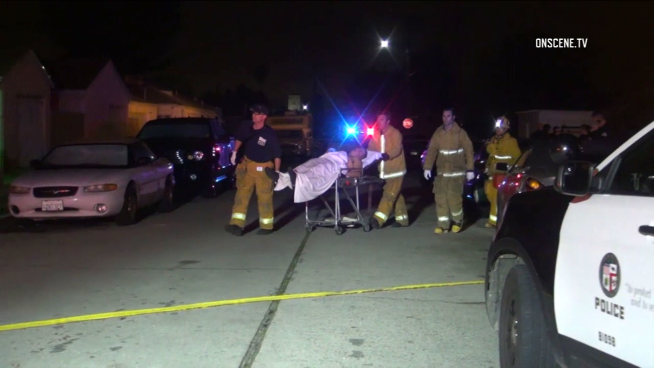 Fire crews help transport a man shot during an attempted robbery in North Hollywood early Sunday morning, Feb. 19, 2017.