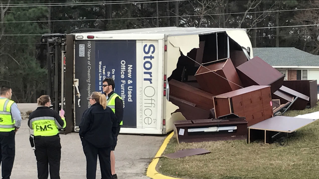 Furniture broke through the roof of the truck and was strewn around. (WTVD photo/Jeff Hinkle)