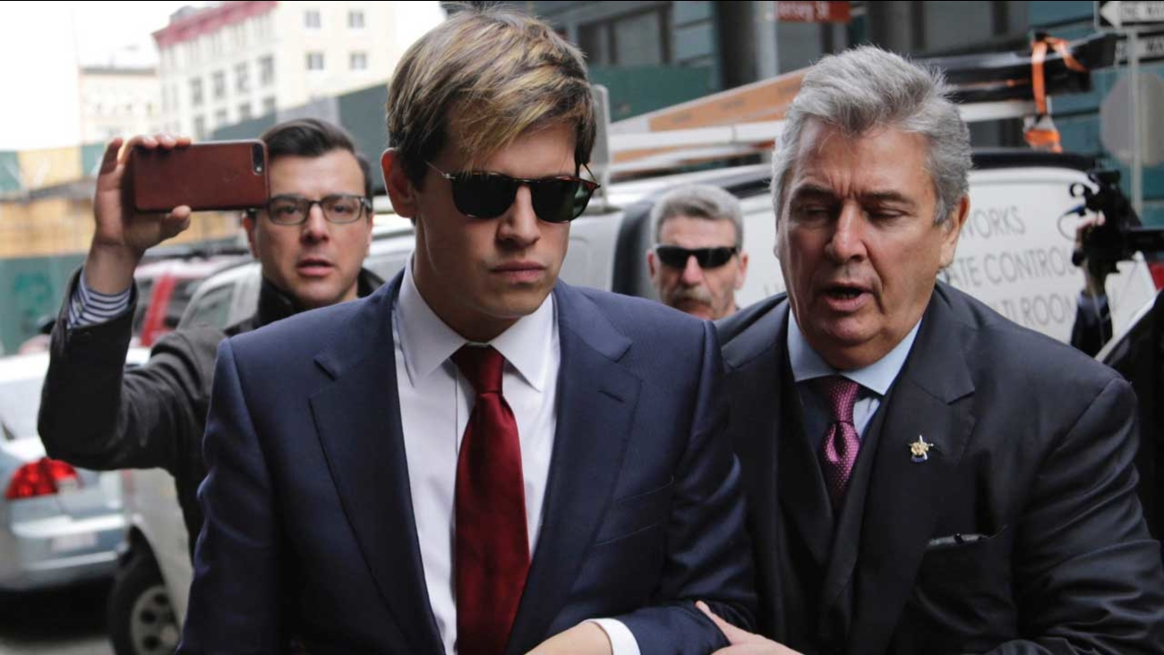 Milo Yiannopoulos, foreground left, arrives for a news conference in New York, Tuesday, Feb. 21, 2017.