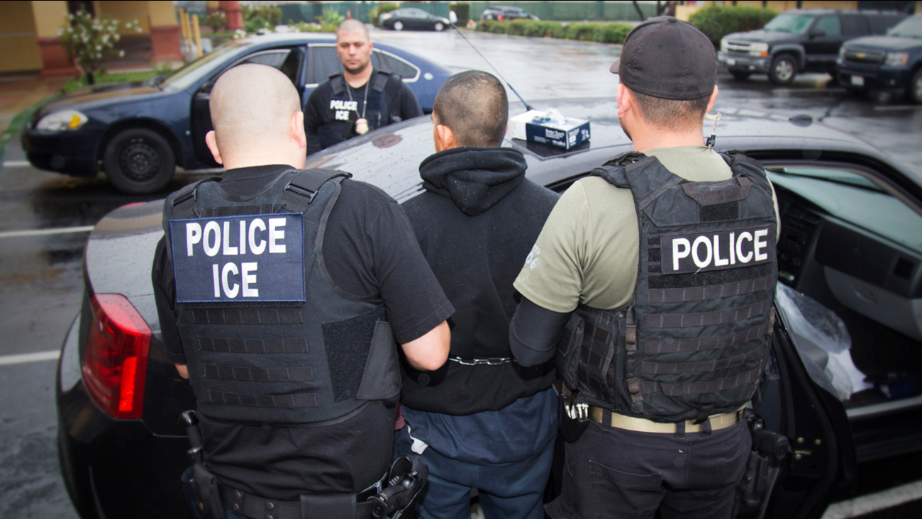 In this Tuesday, Feb. 7, 2017, photo released by U.S. Immigration and Customs Enforcement, foreign nationals are arrested during a targeted enforcement operation.