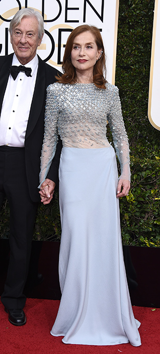 <div class='meta'><div class='origin-logo' data-origin='none'></div><span class='caption-text' data-credit='Jordan Strauss/Invision/AP'>Paul Verhoeven, left, and Isabelle Huppert arrive at the 74th annual Golden Globe Awards at the Beverly Hilton Hotel on Sunday, Jan. 8, 2017, in Beverly Hills, Calif.</span></div>