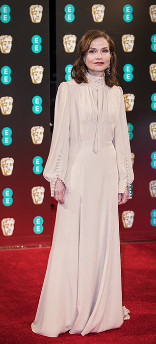 <div class='meta'><div class='origin-logo' data-origin='none'></div><span class='caption-text' data-credit='Vianney Le Caer/Invision/AP'>Isabelle Huppert poses for photographers upon arrival at the BAFTA Film Awards, in London, Sunday, Feb. 12, 2017.</span></div>