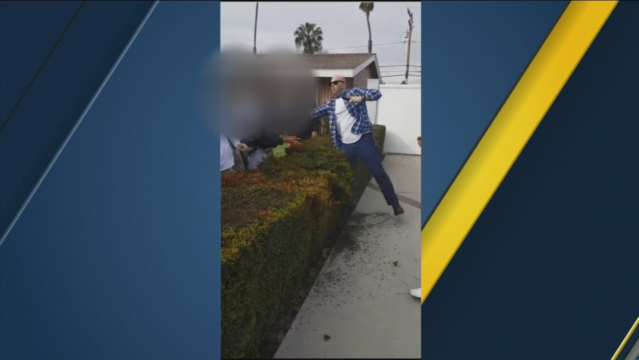This still image shows the moment an off-duty Los Angeles Police Department officer pulled out a gun during a confrontation with teens in Anaheim on Tuesday, Feb. 21, 2017.