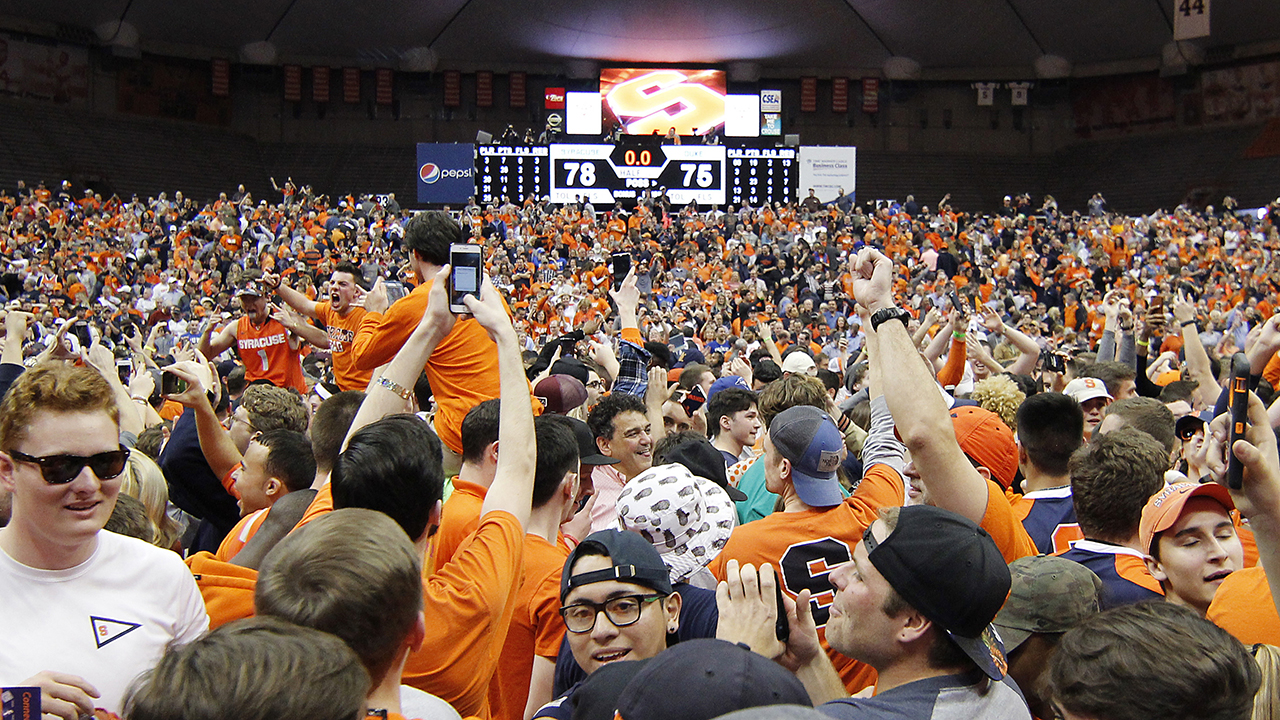 Syracuse fans storm the court in celebration after their upset of Duke.