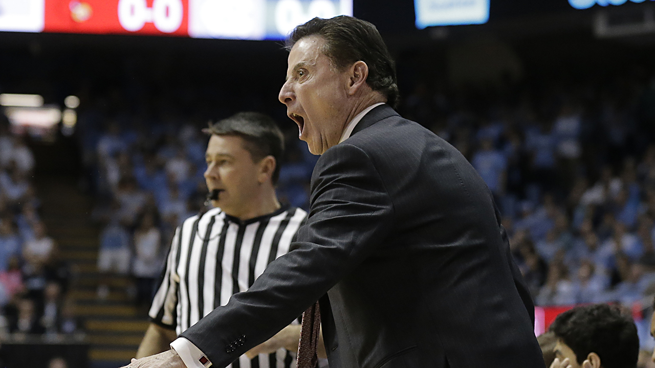 Louisville coach Rick Pitino got into it with a UNC fan at halftime.