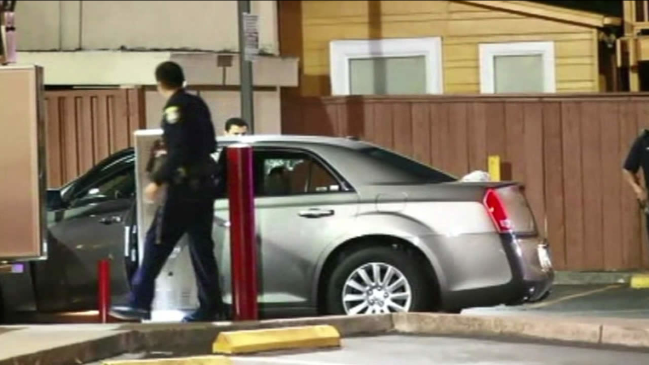 Police investigate a fatal shooting at a Wendy's drive-thru in Oakland, Calif. on July 10, 2014.