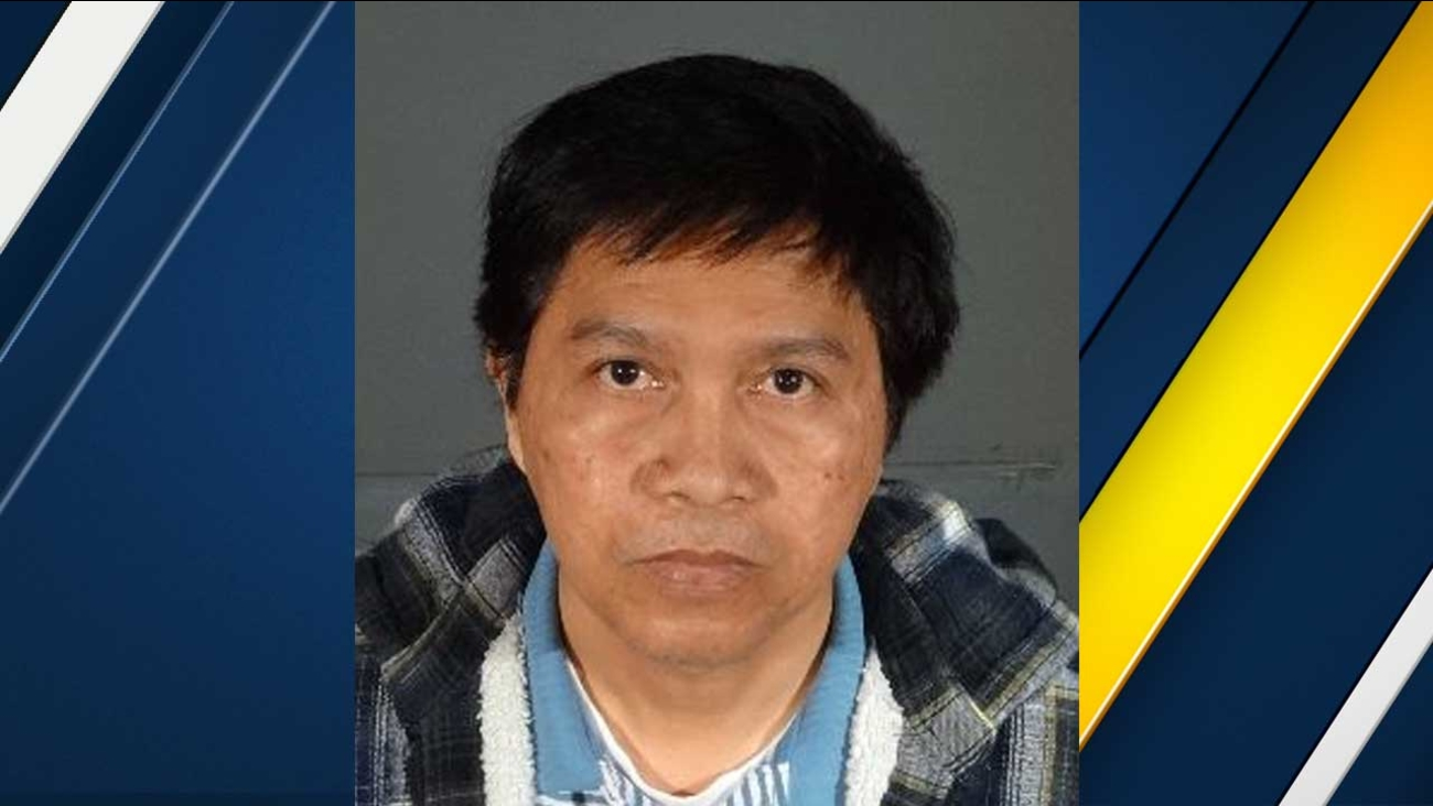 Amador Valencia Santos, also known as 'Omar,' is seen in this booking photo from the Los Angeles Police Department.