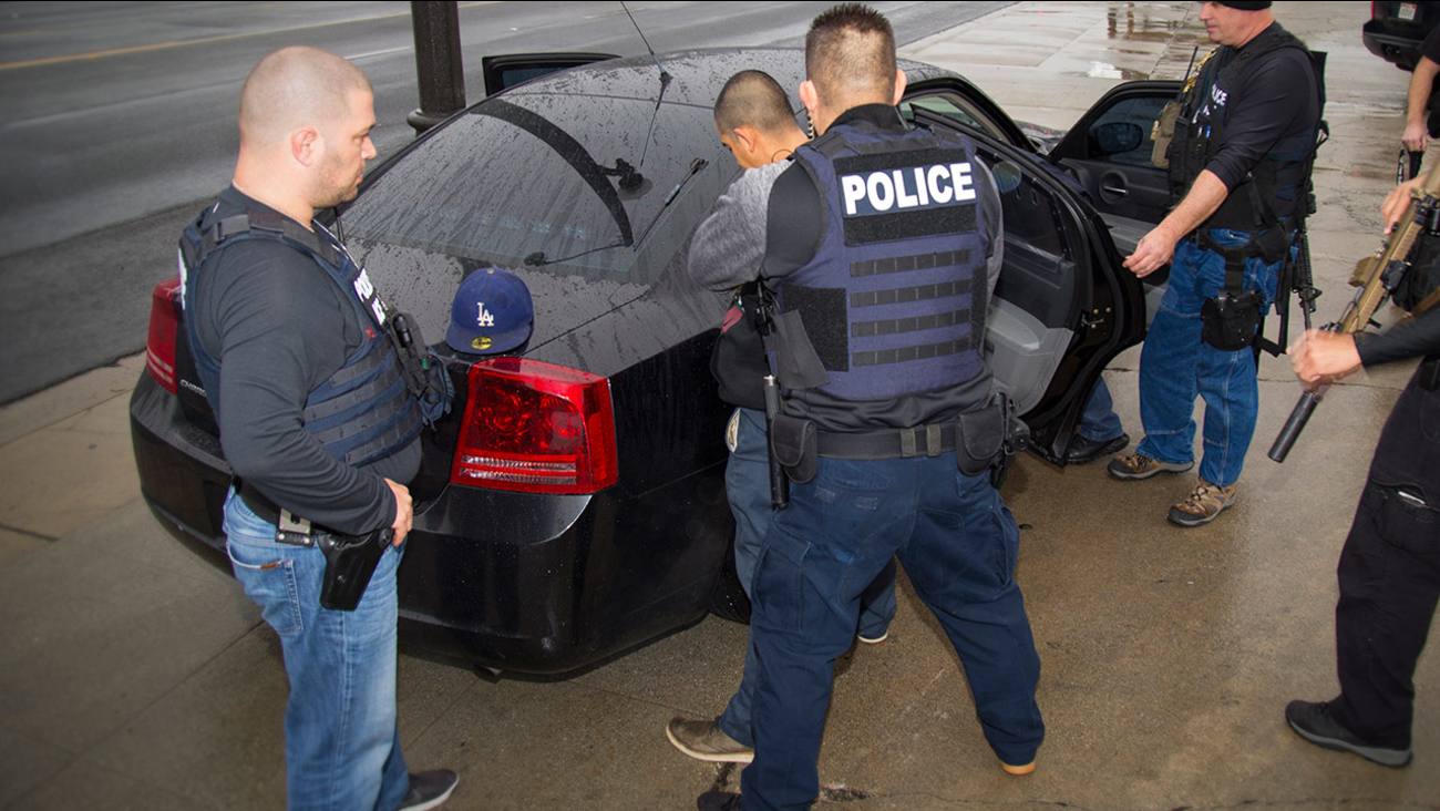 In this Tuesday, Feb. 7, 2017, photo released by U.S. Immigration and Customs Enforcement, a man is arrested in Los Angeles by ICE agents.