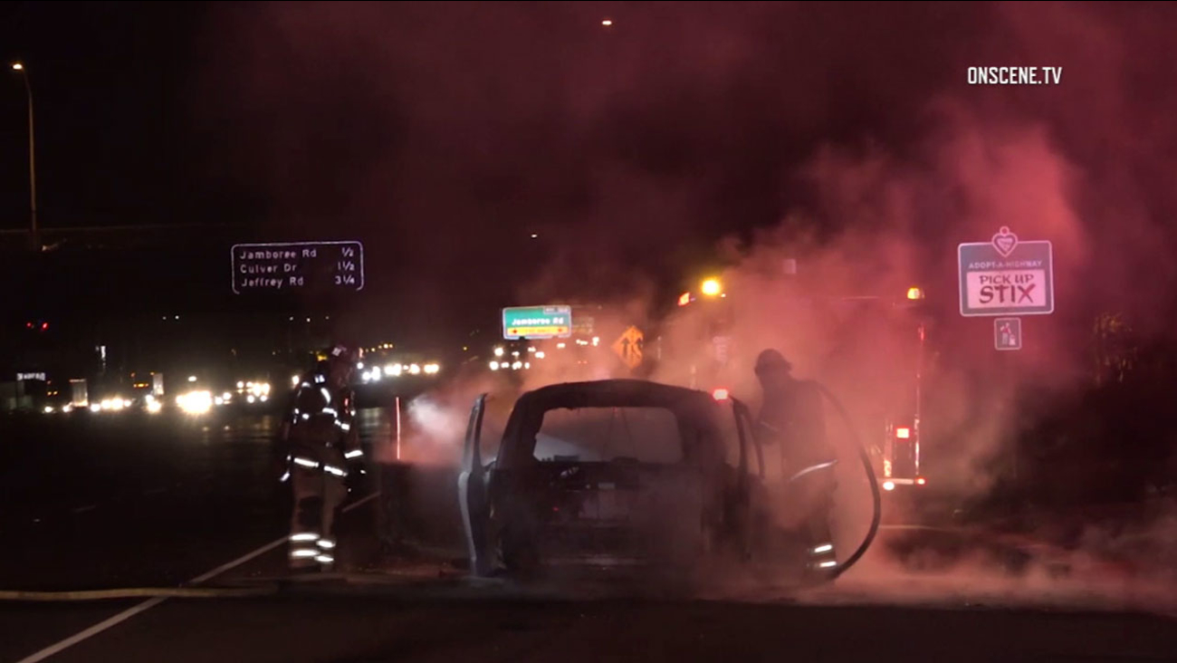Firefighters worked to put out a fire that erupted inside a van along the southbound 5 Freeway in Tustin on Friday, Feb. 24, 2017.