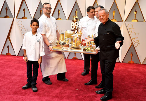 <div class='meta'><div class='origin-logo' data-origin='none'></div><span class='caption-text' data-credit='Photo by Jeff Kravitz/FilmMagic'>Chef Wolfgang Puck presents Oscars cuisine before the 89th Annual Academy Awards at Hollywood & Highland Center on February 26, 2017 in Hollywood, California.</span></div>