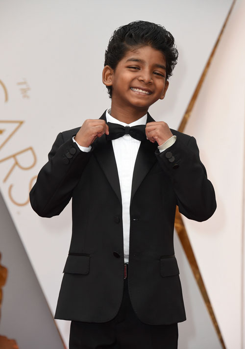 <div class='meta'><div class='origin-logo' data-origin='AP'></div><span class='caption-text' data-credit='Photo by Jordan Strauss/Invision/AP'>Sunny Pawar arrives at the Oscars on Sunday, Feb. 26, 2017, at the Dolby Theatre in Los Angeles.</span></div>