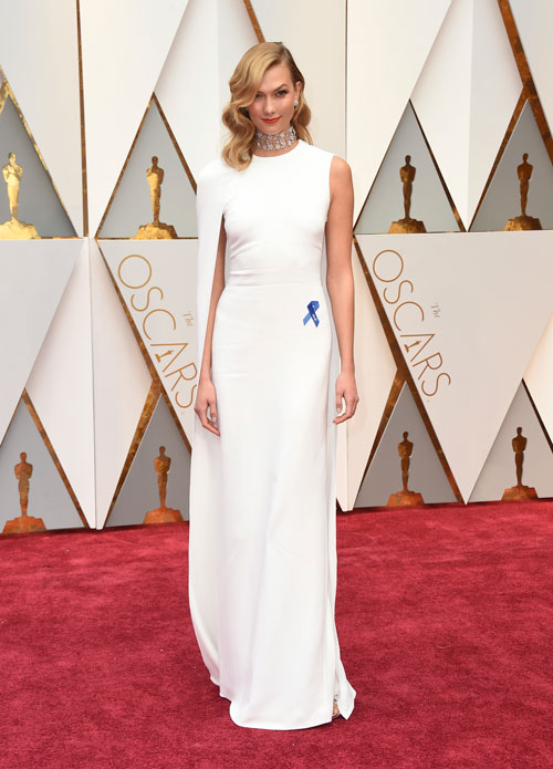 <div class='meta'><div class='origin-logo' data-origin='AP'></div><span class='caption-text' data-credit='Photo by Jordan Strauss/Invision/AP'>Karlie Kloss, wearing the ACLU ribbon, arrives at the Oscars on Sunday, Feb. 26, 2017, at the Dolby Theatre in Los Angeles.</span></div>