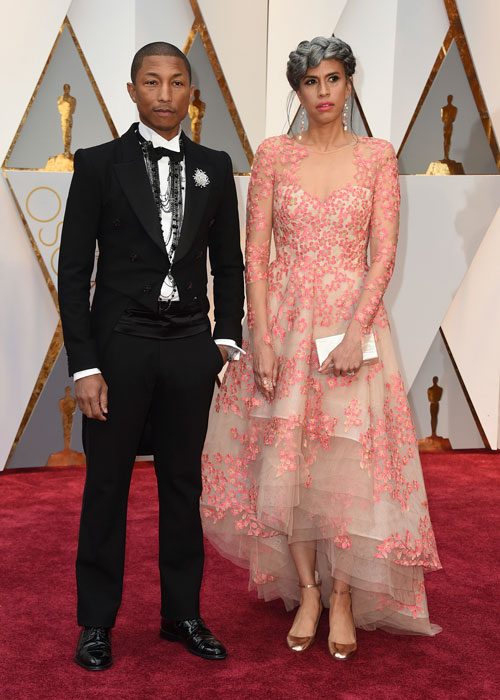"<div class=""meta image-caption""><div class=""origin-logo origin-image ap""><span>AP</span></div><span class=""caption-text"">Pharrell Williams, left, and Mimi Valdes arrive at the Oscars on Sunday, Feb. 26, 2017, at the Dolby Theatre in Los Angeles. (Photo by Jordan Strauss/Invision/AP)</span></div>"