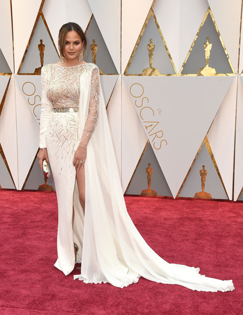 <div class='meta'><div class='origin-logo' data-origin='AP'></div><span class='caption-text' data-credit='Photo by Jordan Strauss/Invision/AP'>Chrissy Teigen arrives at the Oscars on Sunday, Feb. 26, 2017, at the Dolby Theatre in Los Angeles.</span></div>
