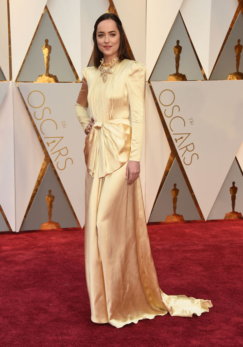 """<div class=""""meta image-caption""""><div class=""""origin-logo origin-image ap""""><span>AP</span></div><span class=""""caption-text"""">Dakota Johnson arrives at the Oscars on Sunday, Feb. 26, 2017, at the Dolby Theatre in Los Angeles. (Photo by Jordan Strauss/Invision/AP)</span></div>"""