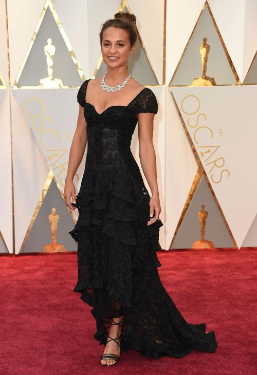"""<div class=""""meta image-caption""""><div class=""""origin-logo origin-image ap""""><span>AP</span></div><span class=""""caption-text"""">Alicia Vikander arrives at the Oscars on Sunday, Feb. 26, 2017, at the Dolby Theatre in Los Angeles. (Photo by Jordan Strauss/Invision/AP)</span></div>"""