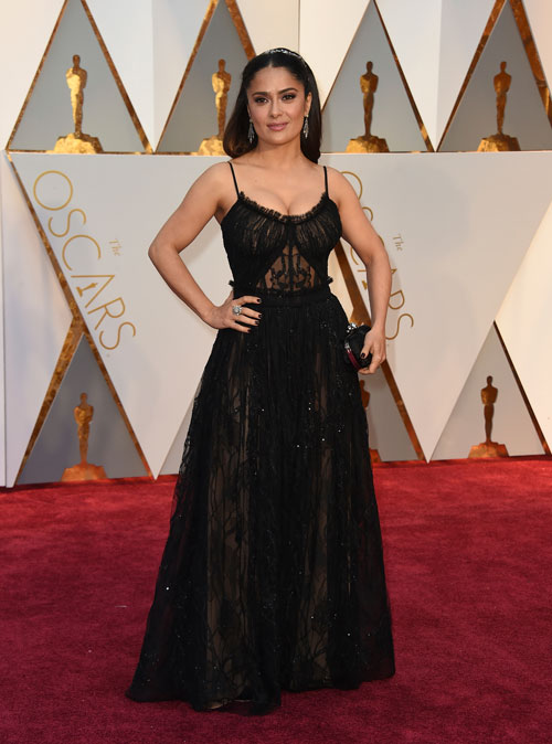 """<div class=""""meta image-caption""""><div class=""""origin-logo origin-image ap""""><span>AP</span></div><span class=""""caption-text"""">Salma Hayek arrives at the Oscars on Sunday, Feb. 26, 2017, at the Dolby Theatre in Los Angeles. (Photo by Jordan Strauss/Invision/AP)</span></div>"""