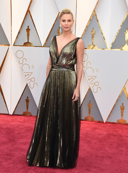 """<div class=""""meta image-caption""""><div class=""""origin-logo origin-image ap""""><span>AP</span></div><span class=""""caption-text"""">Charlize Theron arrives at the Oscars on Sunday, Feb. 26, 2017, at the Dolby Theatre in Los Angeles. (Photo by Jordan Strauss/Invision/AP)</span></div>"""