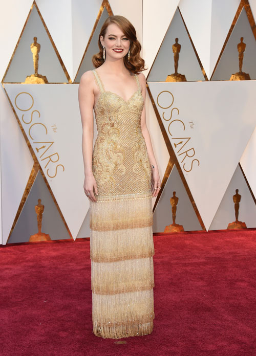 <div class='meta'><div class='origin-logo' data-origin='AP'></div><span class='caption-text' data-credit='Photo by Jordan Strauss/Invision/AP'>Emma Stone arrives at the Oscars on Sunday, Feb. 26, 2017, at the Dolby Theatre in Los Angeles.</span></div>