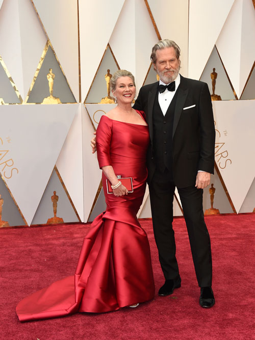 "<div class=""meta image-caption""><div class=""origin-logo origin-image ap""><span>AP</span></div><span class=""caption-text"">Susan Geston, left, and Jeff Bridges arrive at the Oscars on Sunday, Feb. 26, 2017, at the Dolby Theatre in Los Angeles. (Photo by Jordan Strauss/Invision/AP)</span></div>"