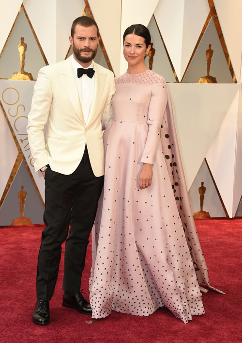 "<div class=""meta image-caption""><div class=""origin-logo origin-image ap""><span>AP</span></div><span class=""caption-text"">Jamie Dornan, left, and Amelia Warner arrive at the Oscars on Sunday, Feb. 26, 2017, at the Dolby Theatre in Los Angeles. (Photo by Jordan Strauss/Invision/AP)</span></div>"