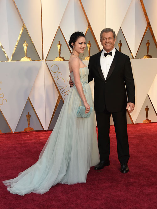 <div class='meta'><div class='origin-logo' data-origin='AP'></div><span class='caption-text' data-credit='Photo by Jordan Strauss/Invision/AP'>Rosalind Ross, left, and Mel Gibson arrive at the Oscars on Sunday, Feb. 26, 2017, at the Dolby Theatre in Los Angeles.</span></div>