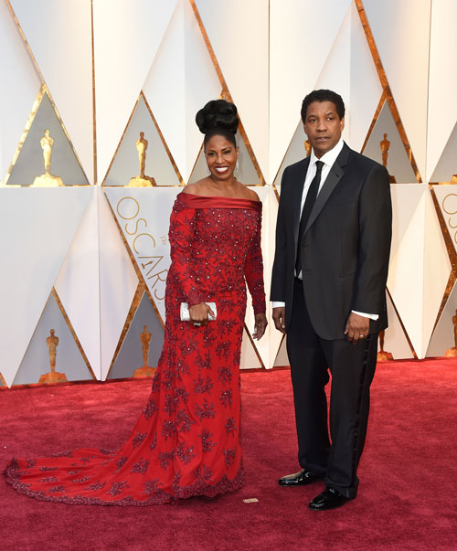 <div class='meta'><div class='origin-logo' data-origin='AP'></div><span class='caption-text' data-credit='Photo by Jordan Strauss/Invision/AP'>Pauletta Washington, left, and Denzel Washington arrive at the Oscars on Sunday, Feb. 26, 2017, at the Dolby Theatre in Los Angeles.</span></div>