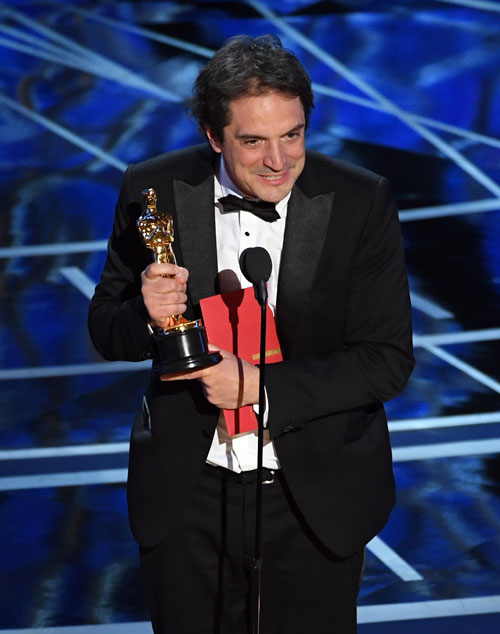 <div class='meta'><div class='origin-logo' data-origin='none'></div><span class='caption-text' data-credit='Photo by Kevin Winter/Getty Images'>Sound editor Sylvain Bellemare accepts Best Sound Editing for 'Arrival' onstage during the 89th Annual Academy Awards at Hollywood & Highland Center on Feb. 26, 2017.</span></div>