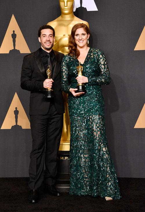 <div class='meta'><div class='origin-logo' data-origin='none'></div><span class='caption-text' data-credit='Photo by Frazer Harrison/Getty Images'>Director Ezra Edelman (L) and producer Caroline Waterlow, winners of Best Documentary Feature for 'O.J.: Made in America.'</span></div>