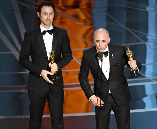 <div class='meta'><div class='origin-logo' data-origin='none'></div><span class='caption-text' data-credit='Photo by Kevin Winter/Getty Images'>Director Alan Barillaro (L) and producer Marc Sondheimer accept Best Animated Short Film for 'Piper' onstage during the 89th Annual Academy Awards at Hollywood & Highland Center.</span></div>
