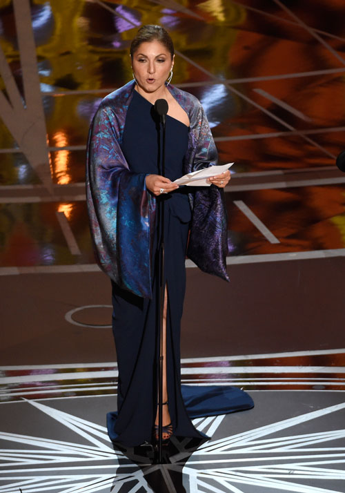 <div class='meta'><div class='origin-logo' data-origin='none'></div><span class='caption-text' data-credit='Photo by Chris Pizzello/Invision/AP'>Anousheh Ansari accepts the award for best foreign language film for &#34;The Salesman&#34; on behalf of Asghar Farhadi at the Oscars on Sunday, Feb. 26, 2017.</span></div>