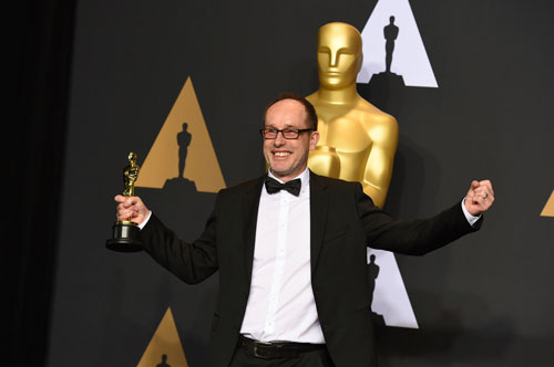 <div class='meta'><div class='origin-logo' data-origin='AP'></div><span class='caption-text' data-credit='Photo by Jordan Strauss/Invision/AP'>John Gilbert poses in the press room with the award for best film editing for &#34;Hacksaw Ridge&#34; at the Oscars on Sunday, Feb. 26, 2017.</span></div>