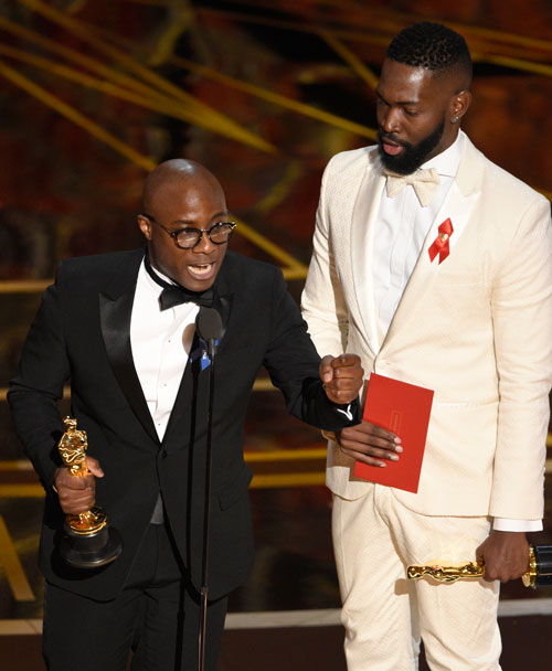 <div class='meta'><div class='origin-logo' data-origin='none'></div><span class='caption-text' data-credit='Photo by Chris Pizzello/Invision/AP'>Barry Jenkins, left, and Tarell Alvin McCraney accept the award for best adapted screenplay for &#34;Moonlight&#34; at the Oscars on Sunday, Feb. 26, 2017.</span></div>
