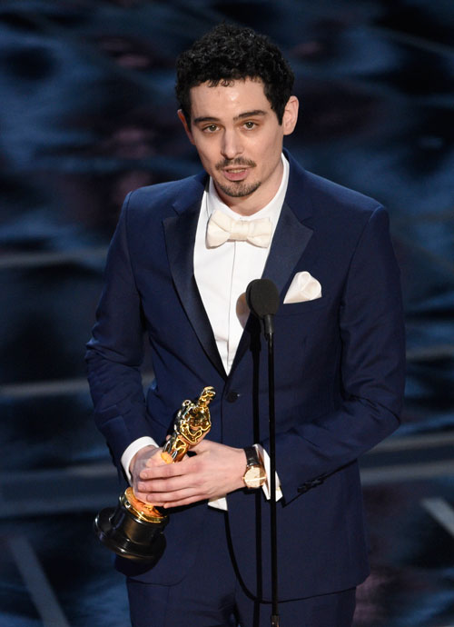 <div class='meta'><div class='origin-logo' data-origin='AP'></div><span class='caption-text' data-credit='Photo by Chris Pizzello/Invision/AP'>Damien Chazelle accepts the award for best director for &#34;La La Land&#34; at the Oscars on Sunday, Feb. 26, 2017, at the Dolby Theatre in Los Angeles.</span></div>