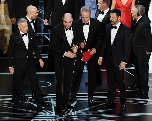 <div class='meta'><div class='origin-logo' data-origin='none'></div><span class='caption-text' data-credit='Photo by Kevin Winter/Getty Images'>'La La Land' producer Jordan Horowitz (L) announces the actual Best Picture winner as 'Moonlight' after a presentation error with actor Warren Beatty (R) onstage.</span></div>