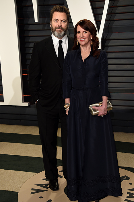 "<div class=""meta image-caption""><div class=""origin-logo origin-image ap""><span>AP</span></div><span class=""caption-text"">Nick Offerman, left, and Megan Mullally arrive at the Vanity Fair Oscar Party on Sunday, Feb. 26, 2017, in Beverly Hills, Calif. (Evan Agostini/Invision/AP)</span></div>"