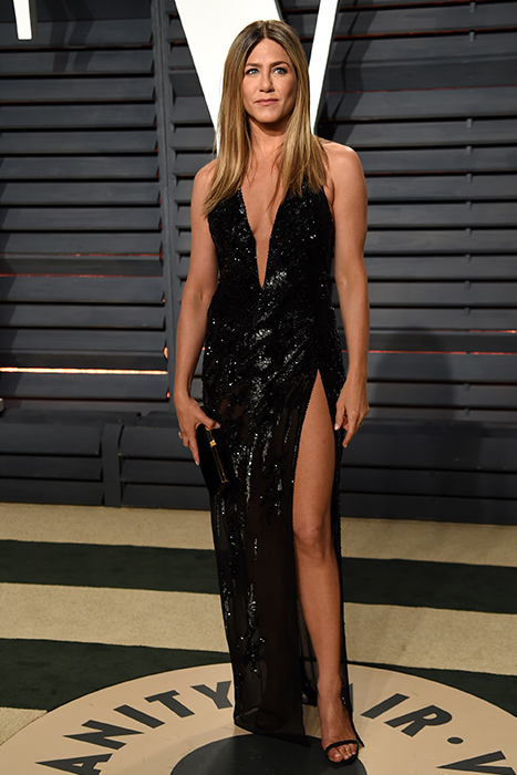 "<div class=""meta image-caption""><div class=""origin-logo origin-image ap""><span>AP</span></div><span class=""caption-text"">Jennifer Aniston arrives at the Vanity Fair Oscar Party on Sunday, Feb. 26, 2017, in Beverly Hills, Calif. (Evan Agostini/Invision/AP)</span></div>"