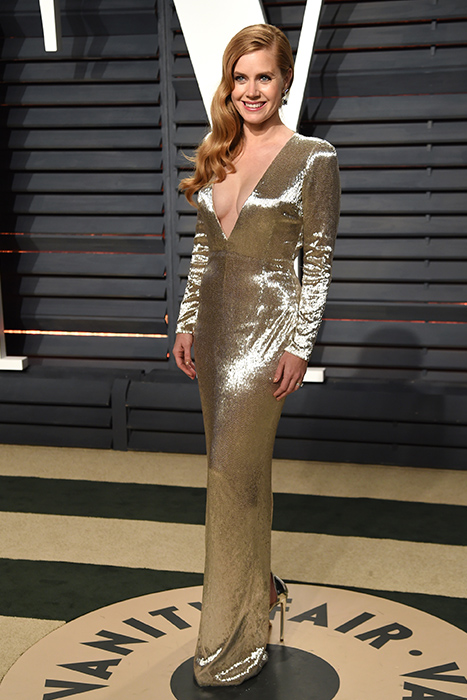 "<div class=""meta image-caption""><div class=""origin-logo origin-image ap""><span>AP</span></div><span class=""caption-text"">Amy Adams arrives at the Vanity Fair Oscar Party on Sunday, Feb. 26, 2017, in Beverly Hills, Calif. (Evan Agostini/Invision/AP)</span></div>"