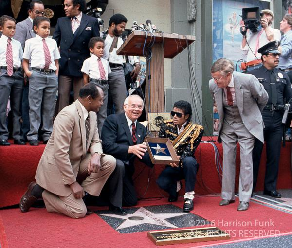 "<div class=""meta image-caption""><div class=""origin-logo origin-image none""><span>none</span></div><span class=""caption-text"">Michael Jackson receives a star on the Hollywood Walk of Fame on Nov. 20, 1984. (Harrison Funk/ALL RIGHTS RESERVED)</span></div>"