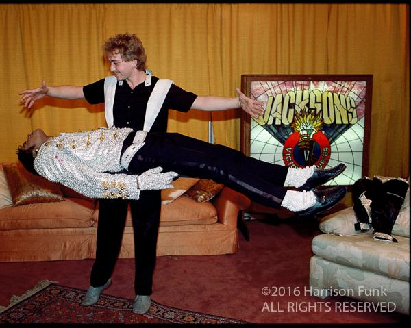 <div class='meta'><div class='origin-logo' data-origin='none'></div><span class='caption-text' data-credit='Harrison Funk/ALL RIGHTS RESERVED'>Michael Jackson is levitated for relaxation courtesy of illusionist Franz Harary backstage before a Victory Tour show.</span></div>