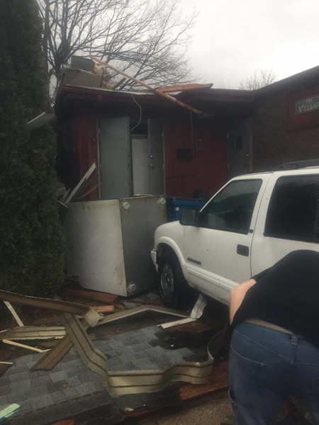 <div class='meta'><div class='origin-logo' data-origin='none'></div><span class='caption-text' data-credit='Gina Chavez'>Storm damage at The Village Grille restaurant in Naplate, Ill., on February 28, 2017.</span></div>