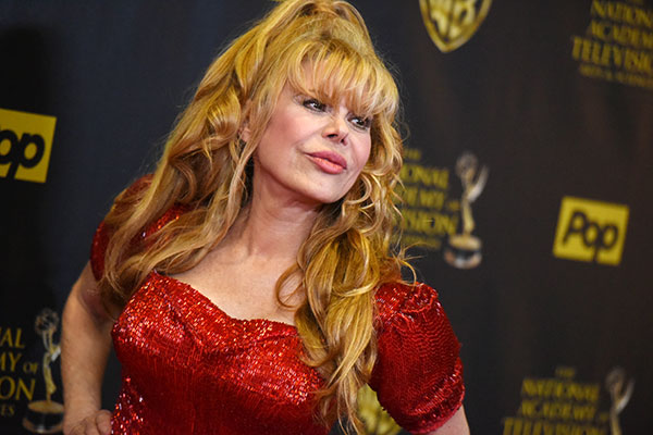 <div class='meta'><div class='origin-logo' data-origin='none'></div><span class='caption-text' data-credit='Richard Shotwell/Invision/AP'>Singer/actress/flamenco guitar player Charo is competing on this season of ''Dancing with the Stars.''</span></div>