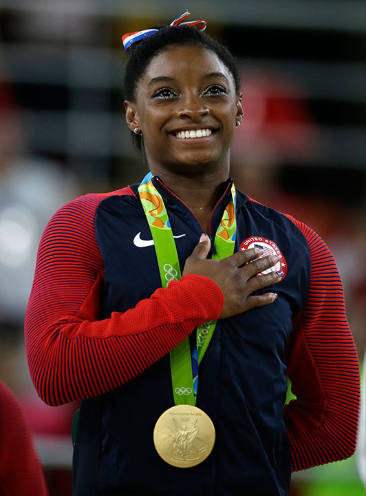 <div class='meta'><div class='origin-logo' data-origin='none'></div><span class='caption-text' data-credit='Rebecca Blackwell/AP Photo'>Simone Biles, the 19-year-old gymnast who took home four gold medals at the Rio Olympics, is competing on this season of ''Dancing with the Stars.''</span></div>