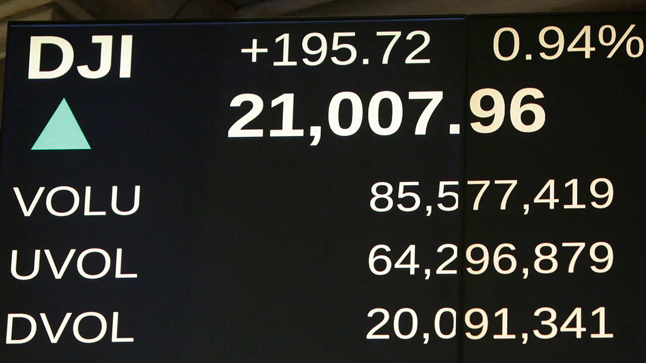 A board above the trading floor of the New York Stock Exchange shows the Dow Jones industrial average above 21,000, Wednesday, March 1, 2017.