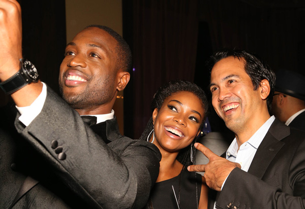 <div class='meta'><div class='origin-logo' data-origin='AP'></div><span class='caption-text' data-credit='Omar Vega/Invision/AP'>Dwyane Wade, Gabrielle Union and Erik Spoelstra, Coach of the Miami Heat, pose for a photo during the RunWade Fashion Show on Saturday, Nov. 14, 2015 in Miami, Fla.</span></div>