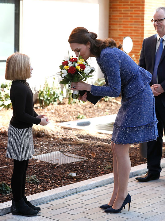 <div class='meta'><div class='origin-logo' data-origin='none'></div><span class='caption-text' data-credit='Kirsty Wigglesworth/AP Photo'>Britain's Kate, the Duchess of Cambridge receives a bouquet of flowers as she arrives at Ronald McDonald House Evelina, in London, Tuesday, Feb. 28, 2017.</span></div>