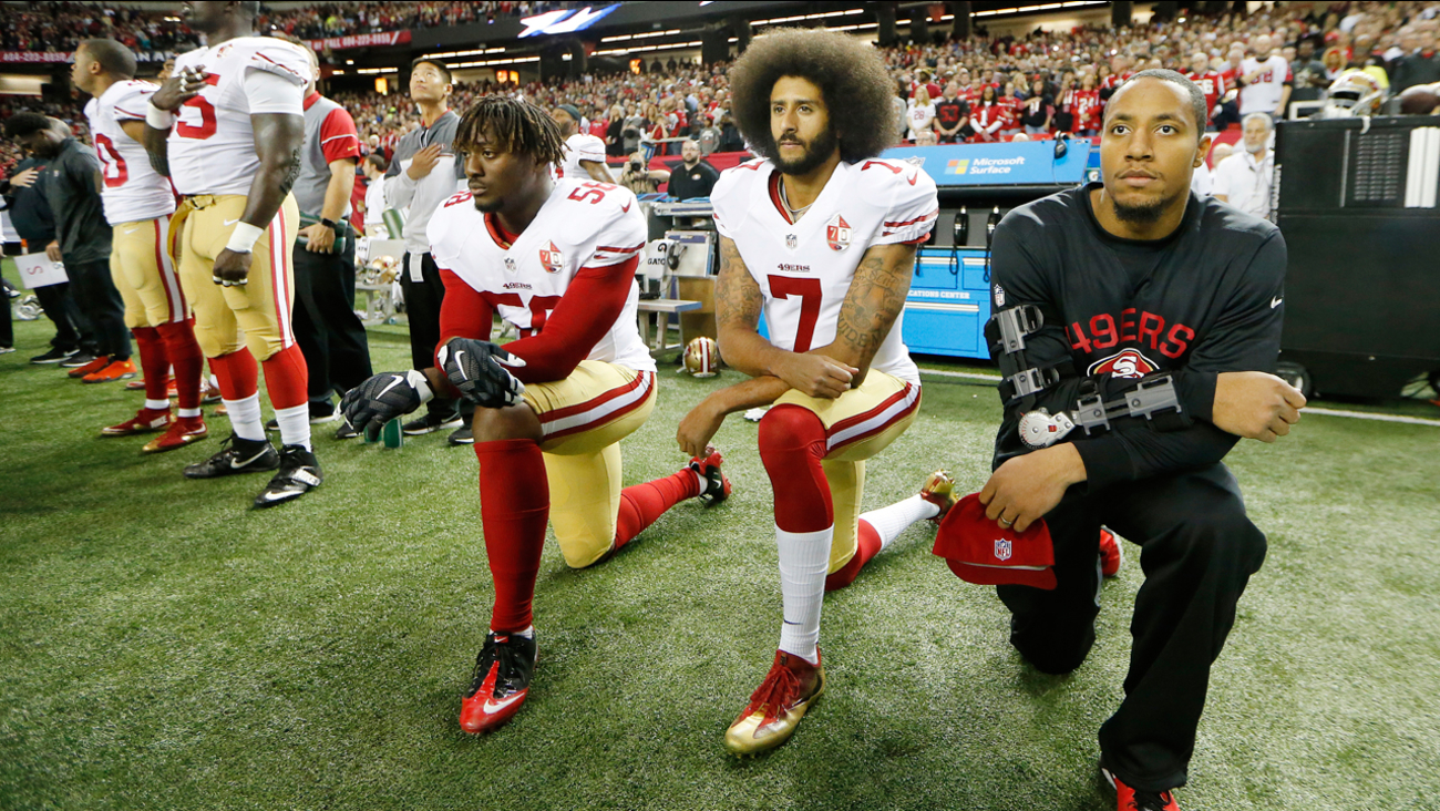 San Francisco 49ers quarterback Colin Kaepernick kneels during the playing of the National Anthem Sunday, Dec. 18, 2016, in Atlanta.