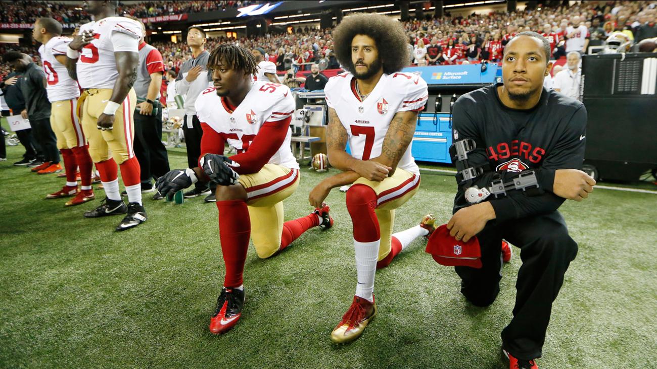 San Francisco 49ers quarterback Colin Kaepernick kneels during the playing of the National Anthem Sunday, Dec. 18, 2016, in Atlanta.