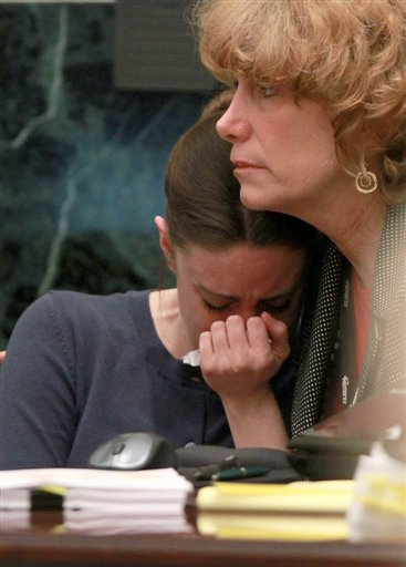 "<div class=""meta image-caption""><div class=""origin-logo origin-image none""><span>none</span></div><span class=""caption-text"">Casey Anthony is comforted by her attorney Dorothy Clay Sims during Anthony's murder trial at the Orange County Courthouse, Friday, June 10, 2011 in Orlando, Fla. (AP)</span></div>"