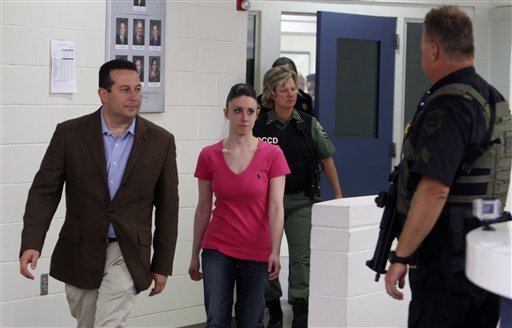 "<div class=""meta image-caption""><div class=""origin-logo origin-image none""><span>none</span></div><span class=""caption-text"">Casey Anthony, center, walks out of the Orange County Jail with her attorney Jose Baez, left,  during her release in Orlando, Fla., early Sunday, July 17, 2011. (ASSOCIATED PRESS)</span></div>"